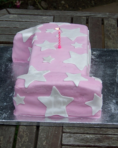 pink first birthday cake