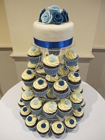 blue wedding cake and cupcakes