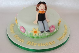 flower and figure birthday cake