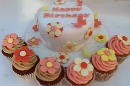 flower birthday cake and cupcakes