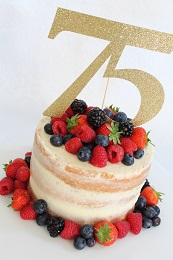 fruit topped semi naked cake