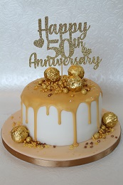 golden wedding anniversary drip cake