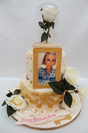 ornate gold and rose birthday cake