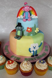 trolls birthday cake and cupcakes